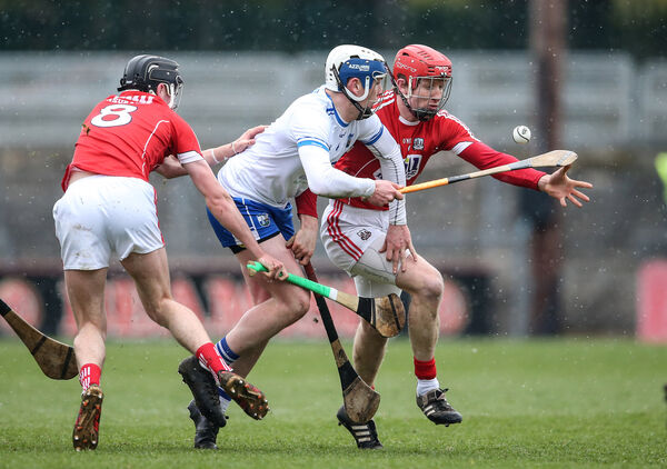 Stephen Bennett is challenged by Bill Cooper. Picture: INPHO/Cathal Noonan