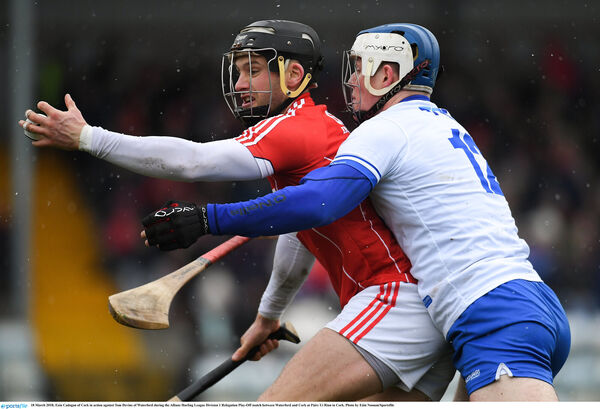 Cadogan holds off Tom Devine. Picture: Eóin Noonan/Sportsfile