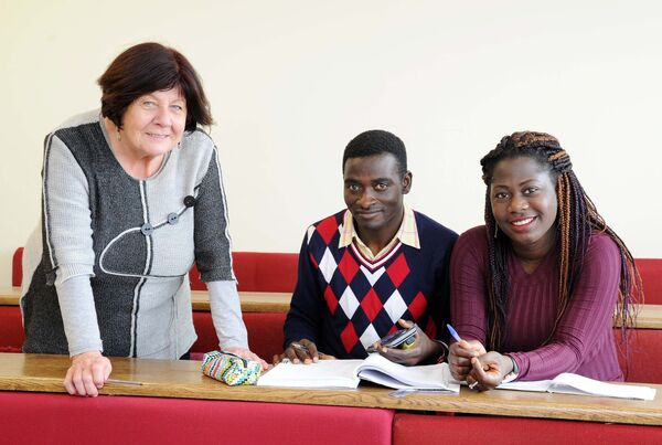 Samuel Opoku and Vivian Aimiuwu who are studying the adult leaving certificate programme at Cork College of Commerce, photographed with Miriam De Barra, head of department, leaving certificate courses, Cork College of Commerce. Picture: Denis Minihane.