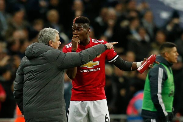 Jose Mourinho talks with Manchester United's French midfielder Paul Pogba. Picture: Getty