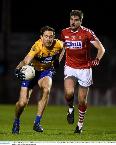 Gary Brennan of Clare in action against Ian Maguire of Cork. Picture: Matt Browne/Sportsfile
