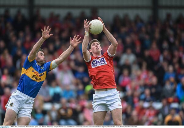 Kevin Crowley reaches for the ball ahead of Liam McGrath of Tipperary. Picture: Matt Browne/Sportsfile