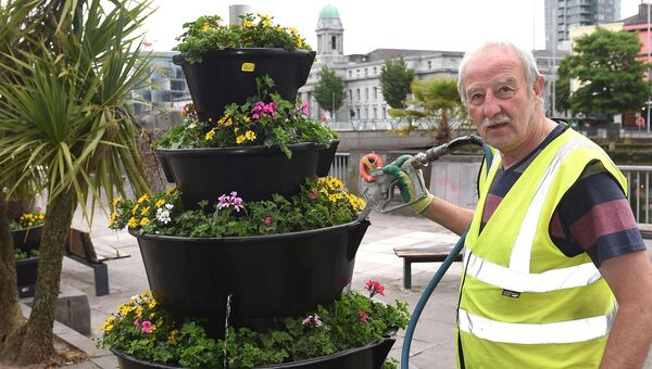 Pat O'Sullivan of Cork City Council, Parks and Recreation Dept. watering a floral display on South Mall. Pic; Larry Cummins