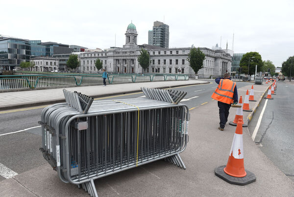 Cork City Council Traffic Dept painting kerbing on traffic island outside City Hall. Pic; Larry Cummins