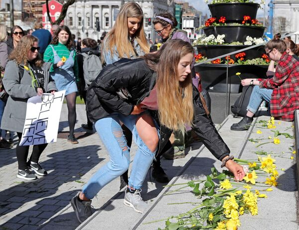 General View at the Rally, a supporter placing her flower on the steps of City Hall. Picture: Jim Coughlan.