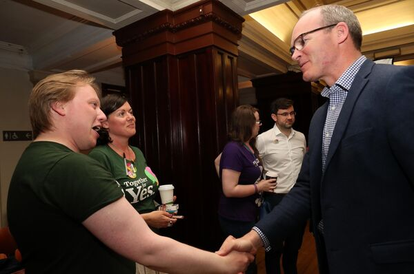 Luke Field and Kathy Darcy, Cork Together for Yes with Simon Coveney TD, at City Hall. Picture: Jim Coughlan.