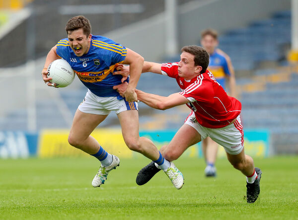 Tipperary's Robbie Kiely with Mark Collins of Cork. Picture: INPHO/Oisin Keniry