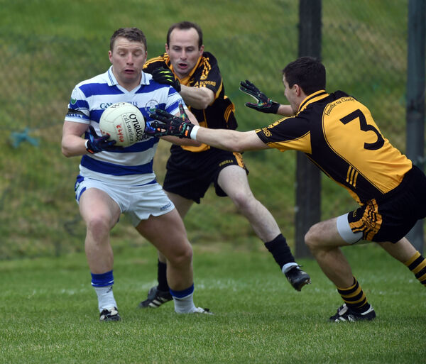 Castlehaven's Brian Hurley is tackled by Clyda Rovers' Ray Carey and Niall O'Mullane. Picture: Eddie O'Hare