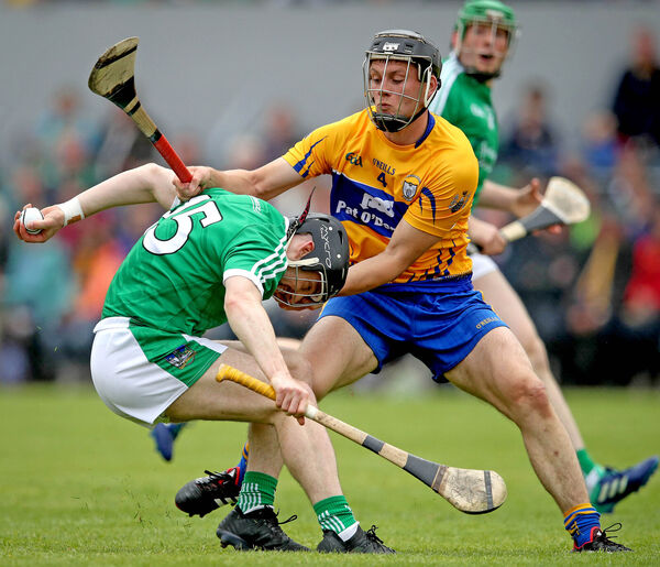 Clare's Jack Browne drags at Graeme Mulcahy of Limerick. Picture: INPHO/Ryan Byrne