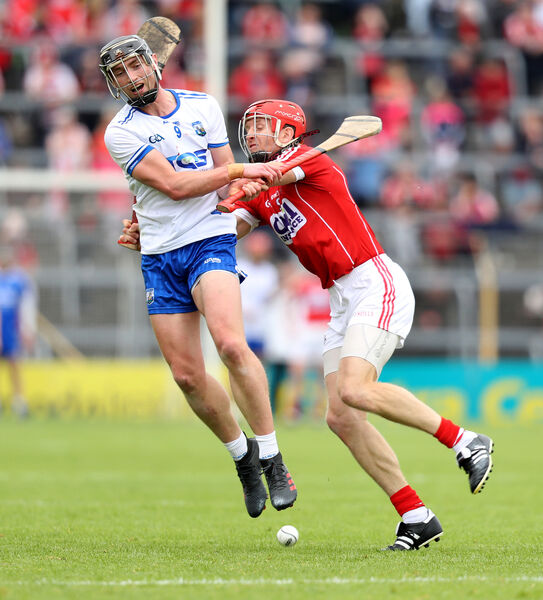 Bill Cooper tackles Pauric Mahony. Picture: INPHO/Oisin Keniry