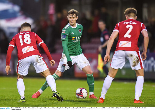 Kieran Sadlier looks for a way past Callum Waters, left, and Gary Boylan. Picture: Eóin Noonan/Sportsfile