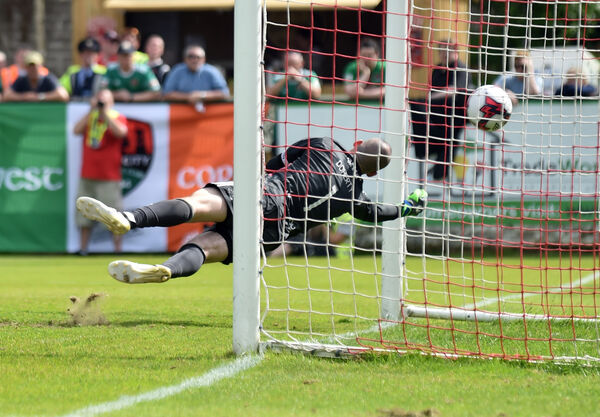 Derry goalkeeper Gerard Doherty dives in vain to stop the free kick by Kieran Sadlier. Picture: Eddie O'Hare