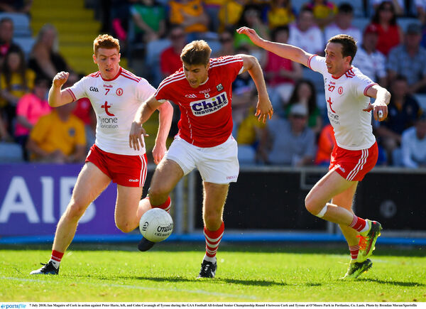 Ian Maguire of Cork in action against Peter Harte, left, and Colm Cavanagh. Picture: Brendan Moran/Sportsfile