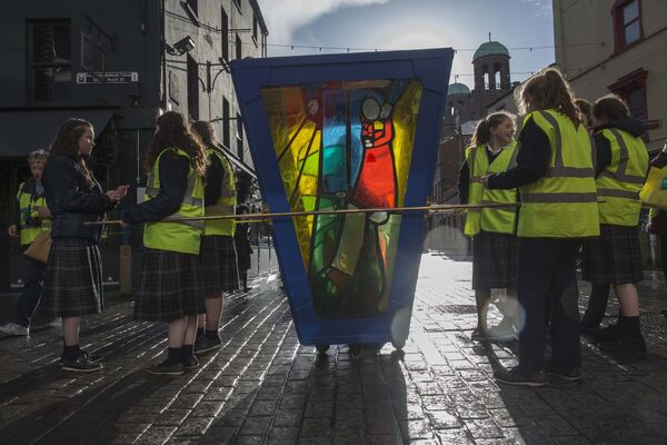 Students of St Mary's High School Midleton with their Lantern Artwork which they walked through the city during the Twilight walk. Picture: Clare Keogh