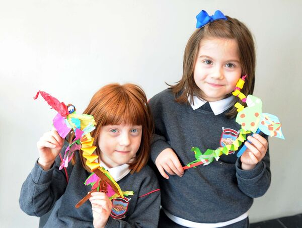 Twins Scarlet and Saoirse Collins from Rockboro Primary School with their artwork.