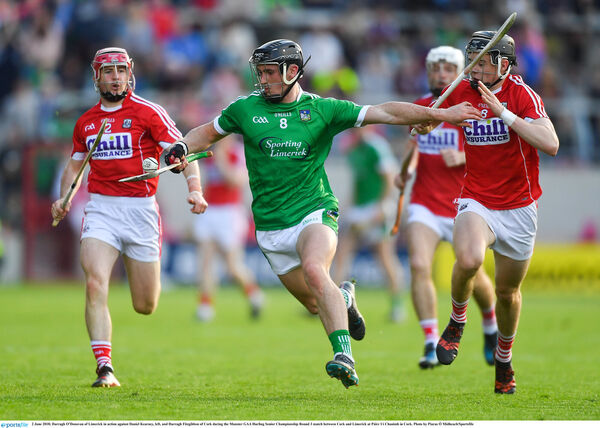 Darragh O'Donovan tries to get away from Daniel Kearney and Darragh Fitzgibbon. Picture: Piaras Ó Mídheach/Sportsfile