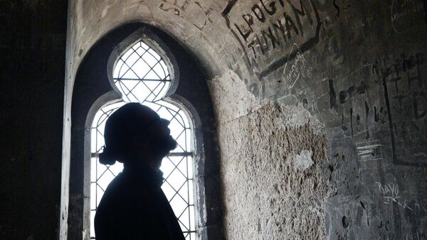 Kieran Murphy, researcher, Cork Folklore Project, looking at inscriptions on the walls in the bell tower in the North Cathedral some of which date back to the 19th century. Picture: Denis Minihane.