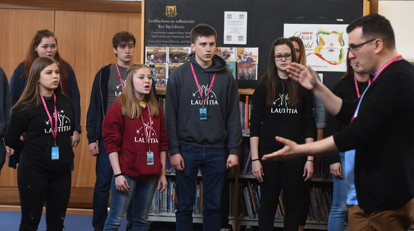 Lautitia Chamber Choir, from Hungary, played at Tory Top Public Library in a free recital.Members watch choir director Jozsef Memes as he directs the choir. Pic; Larry Cummins