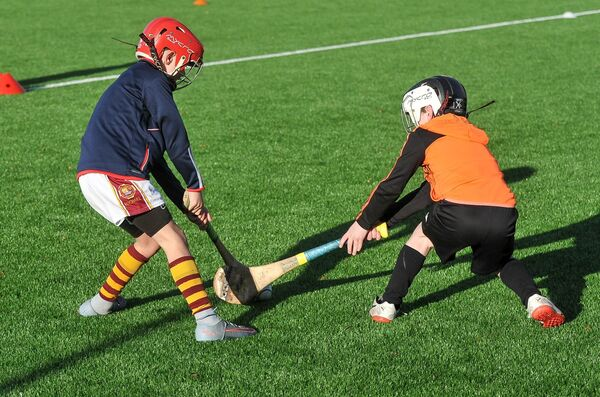 Youghal's Andy O'Sullivan and Midleton's Ciaran O'Brien tussle for the ball during the Rebel Óg U8 blitz on the Páirc astro last year. Picture: David Keane.