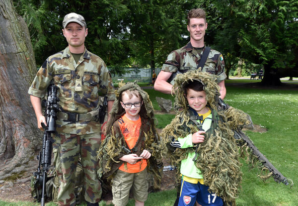 Billy Clancy and Cian Sheedy from Ballygown, North Cork in camouflage ghillie suit with Pte. Dave Le Gear and Pte. Darren Sweeney during the Defence Forces Open day, in conjunction with Cork City Council at Fitzgeralds Park.Picture: Eddie O'Hare