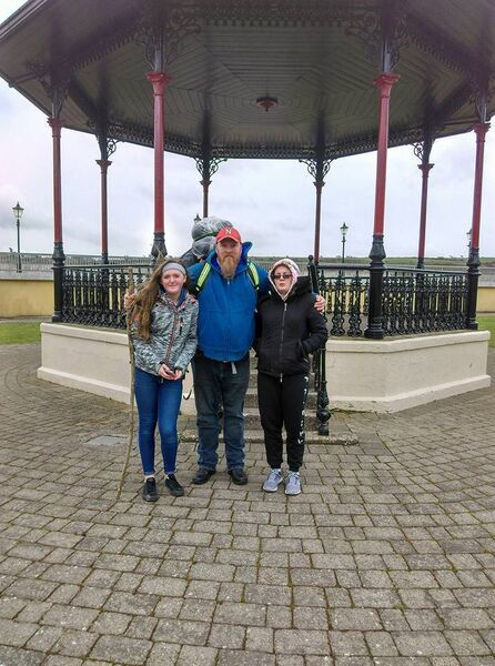 BEST FOOT FORWARD: Michael in Youghal at the start of his walk with daughters Ciara (right) and Leah.