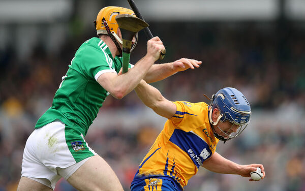 Clare's Podge Collins and Richie English of Limerick. Picture: INPHO/Ryan Byrne