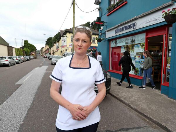 Annette Foley, Passage West Pharmacy, says the road closure will limit access to shops and to services such as the GP, pharmacy, and post office. 	Picture: Jim Coughlan