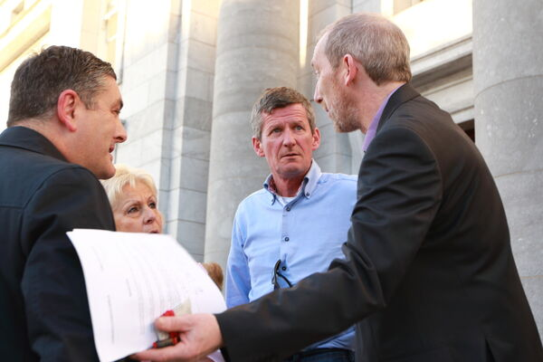 Eddie Mullins, Fitzgerald's Menswear; Pam O'Regan, Gentlemen's Quarters and Tom Durcan, Durcan Meats with Cllr Tom O'Driscoll on the steps of City Hall. Picture: Ger Bonus