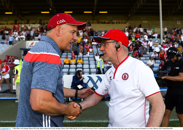 Ronan McCarthy shakes hands with Tyrone manager Mickey Harte. Picture: Eóin Noonan/Sportsfile