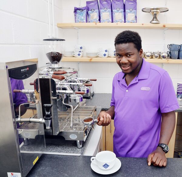 Maurice Attikossie, one of the baristas in training, making an Americano coffee in the new Roots Coffee House at Beech Hill Garden Centre, Cope Foundation, Montenotte. Picture: Denis Minihane.