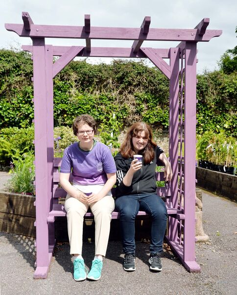Cáit Harnedy (left) and Tracey Duggan, two of the barista trainees, relaxing outside the new Roots Coffee House at Beech Hill Garden Centre, Cope Foundation, Montenotte. Picture: Denis Minihane.