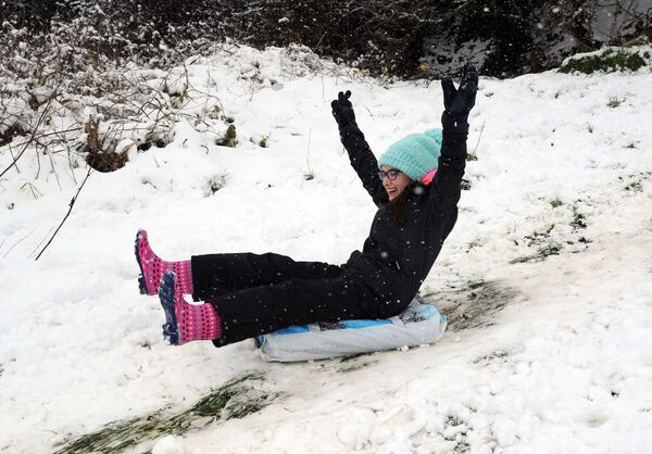 Aisling Kelleher enjoying the snow near Model Farm Road, Cork. Picture: Denis Minihane.
