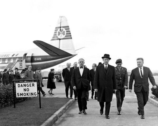 Taoiseach, Jack Lynch, arriving in Cork to attend church ceremonies, is met by Cork Airport management.
