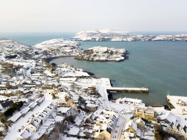 An aerial view of Baltimore Village in west Cork after last weekend's snowfall. 	Picture: Youen Jacob/Provision