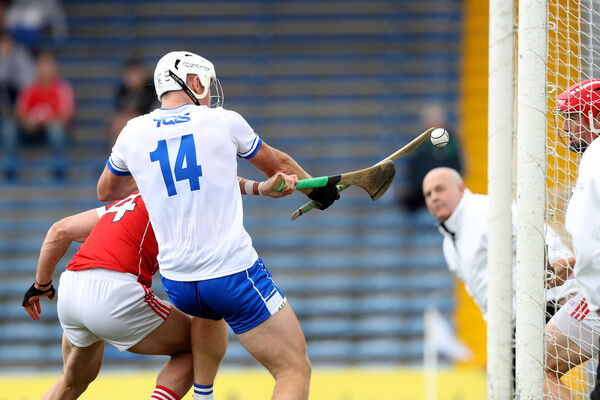 Anthony Nash, Colm Spillane and Tom Devine watch the sliotar dropping in the goalmouth. Picture: INPHO/Oisin Keniry