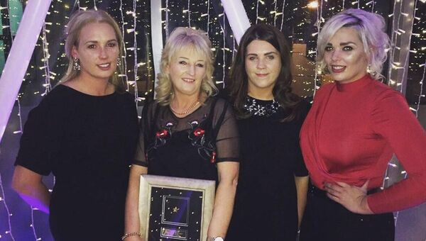 Mum Julie picks up the Mercy Stars Award, in honour of Garry, along with daughters Ciara, Orla and Niamh.