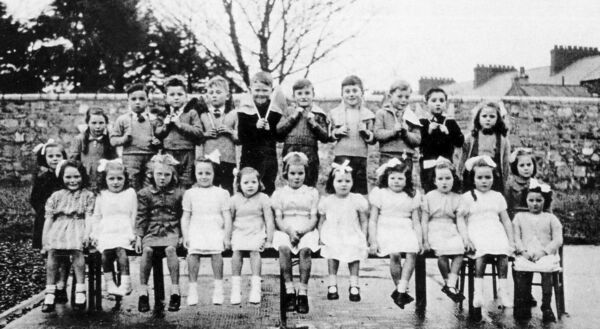 LINING UP: Junior Infants Class, 1944, including, front row seated, fourth from left: Cora Twomey; sixth from left: Kathleen Noonan, and tenth from left: Catherine O'Byrne.