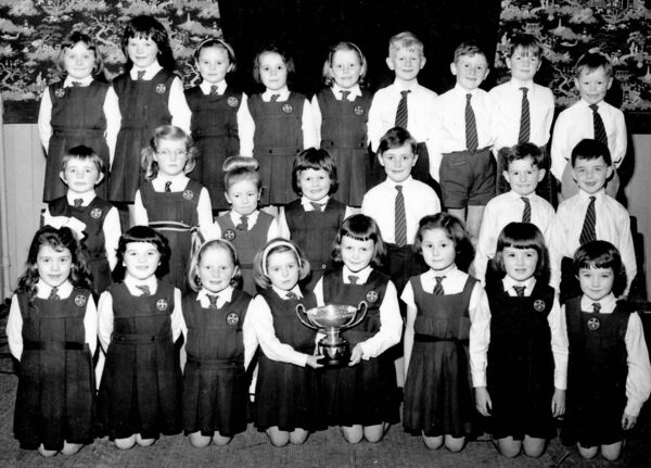 A SINGING TRADITION: Students from Our Lady of Lourdes School who were winners in 1966 at Feis Maitiu, featuring twins Mary (fifth left, back row) and Helen Hegarty (third in the front row). Mary will be singing in the 'Come Celebrate' concert at Cork Opera House on May 10.