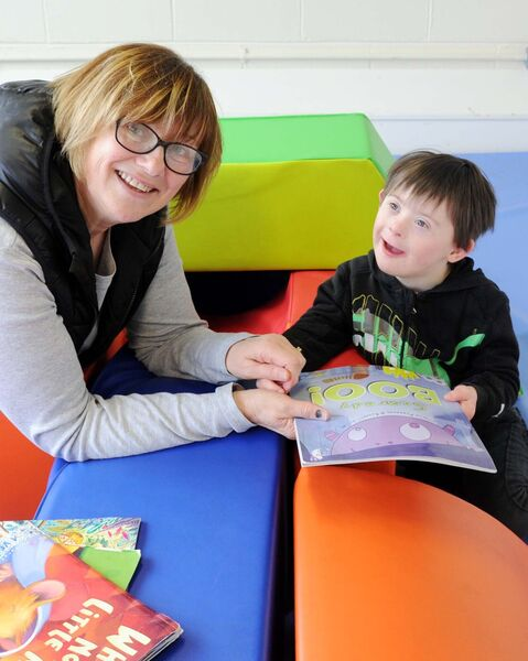 Liz Gill, SNA, with pupil Robert Campion in a play area at St Gabriel's.Picture: Denis Minihane.