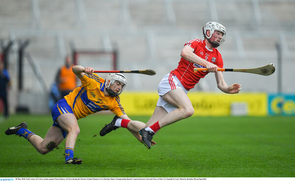 Paul Cooney of Cork in action against Fionn Slattery​ of Clare. Picture: Brendan Moran/Sportsfile