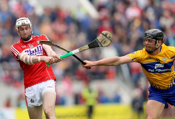Tim O'Mahony with Cathal Malone. Picture: INPHO/Oisin Keniry