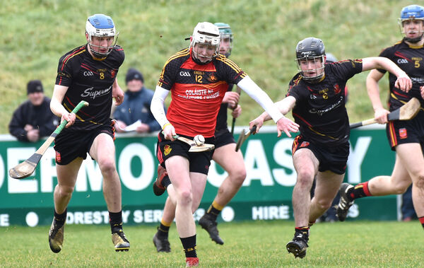 Shane Barrett, CBC, bursting past Ardscoil Rís players Diarmuid Ryan and Ronan Connolly. Picture: Dan Linehan