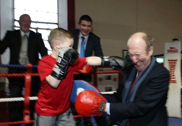 30/11/2017. Minister Ross Boxing. Pictured (LtoR) Kalvin Keenan (10) from Arbour Hill sparring with Minister for Transport, Tourism and Sport, Shane Ross TD as Gold Medalist Michael Carruth and Minister of State for Tourism and Sport Brendan Griffin TD look on in the Arbour Hill Boxing Club. Where they announced where they will announce allocations of €56million to sports clubs and organisations located throughout the country. Photo: Sam Boal/Rollingnews.ie