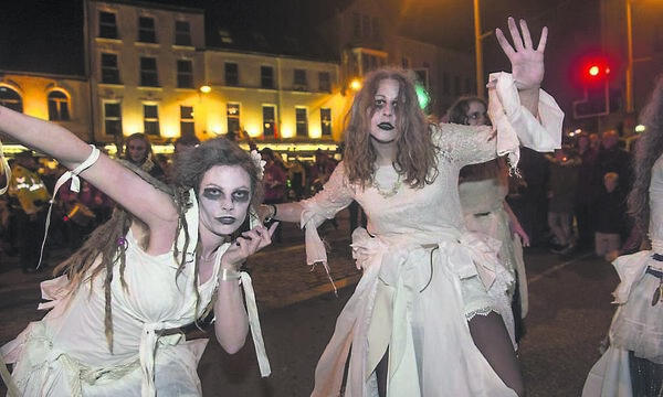 Not your usual crowd on Coal Quay: Ghosts and Ghouls at the Dragon of Shandon street parade celebration of Samhain in Cork. 	Picture: Dan Linehan