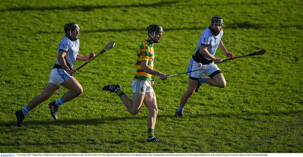Tadhg Deasy of Blackrock in action against Alan Dempsey and Eoin Smith of Na Piarsaigh. Picture: Daire Brennan/Sportsfile