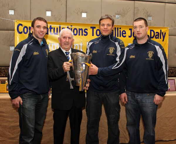 Willie John Daly with the Seán Óg Murphy Cup in 2011 and Carrigtwohill hurlers Brian Lordan, Niall McCarthy and Michael Fitzgerald. Picture: Jim Coughlan.