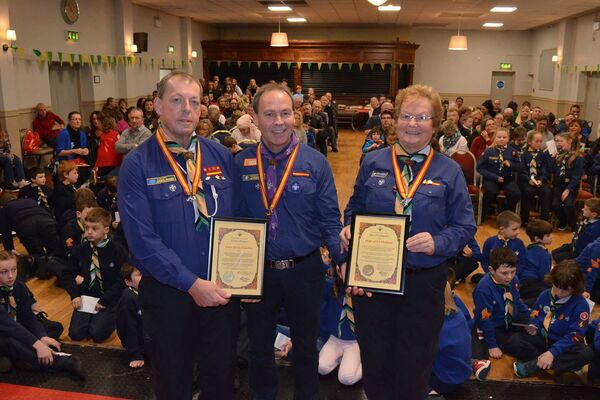 The Chief Scout Christy McCann presenting Scouting Irelands premier award, the Order of Cu Chulainn to Kieran Horgan and Kay O'Callaghan at a special ceremony held at the Blackrock Hurling and Football Clublast Sunday. Pic: D.P.Barry