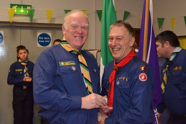 South County Commissioner Richard Pumphrey (right) presenting a 40 year adult service medal to Harry Kidney from the 17th/51st Cork (Blackrock) at a special awards ceremony for the group last Sunday. Pic: D.P.Barry