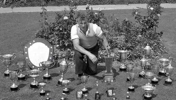 Mick Barry displays some of the cups and trophies he won over the years in his garden. 	Picture: Kevin Cummins