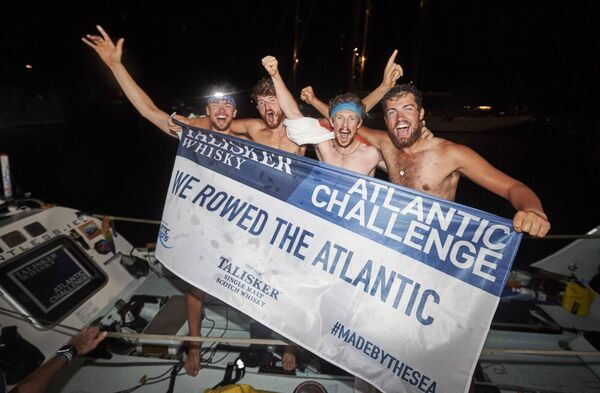 Irish Team Relentless at the finish line of the Talisker Whisky Atlantic Challenge L-R Sean Underwood, Patrick O'Connor, Thomas Browne & Eoin O'Farrell CREDIT BEN DUFFY.
